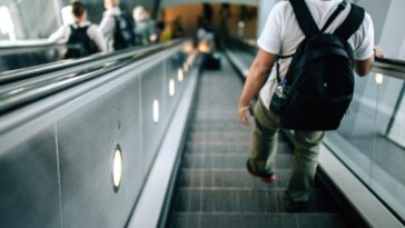 avoid walking on escalators